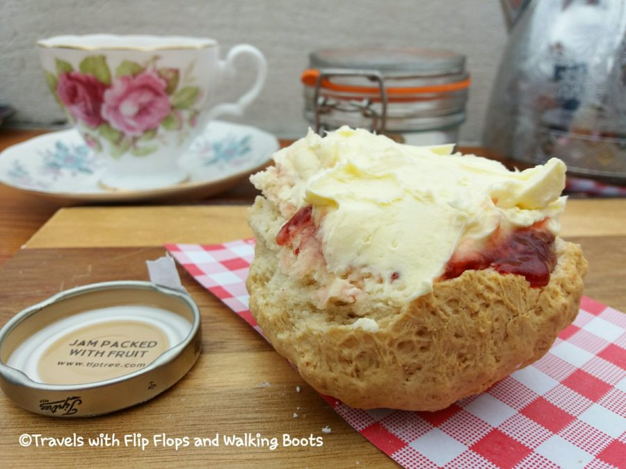 Huge Rock Pool Cafe Mousehole Scone with Jam and Cream on Top, Eaten the Cornish Way